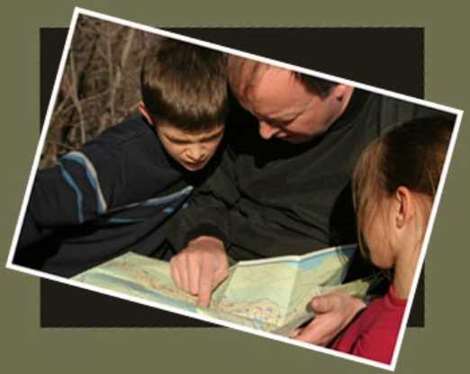 Father pointing on map to sons